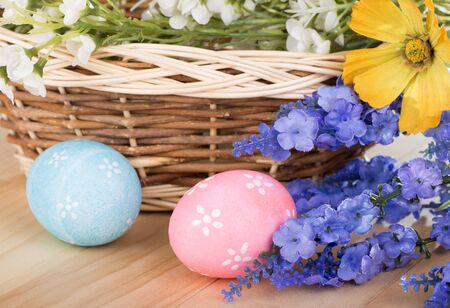 Colorful Easter decoration with colored eggs, flowers and basket
