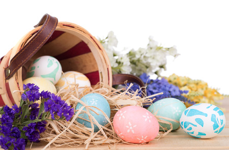 Easter eggs spilled from a basket on a white background Banco de Imagens