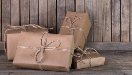 Assortment of brown packages on a wood background Banco de Imagens