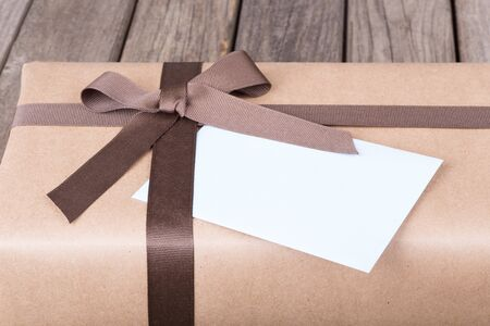 Closeup of a brown gift box tied in ribbon and bow Banco de Imagens