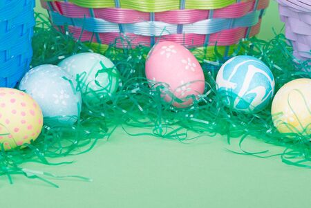 Easter eggs with colored grass and  baskets Banco de Imagens