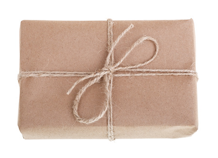 Gift wrapped in brown paper, tied with string isolated on white Banco de Imagens