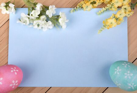 Blue envelope with decorated Easter eggs and flowers around border Banco de Imagens