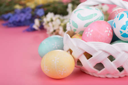 Decorated Easter eggs on a pink surface