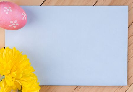 Blank envelope with decorated Easter egg and flower Banco de Imagens