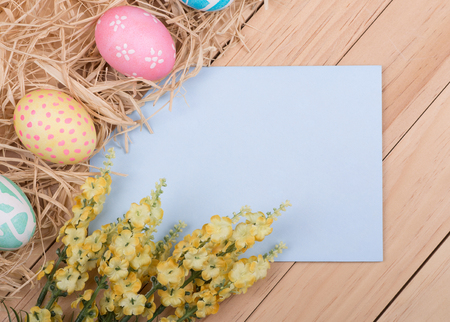 Blank envelope bordered with decorated Easter eggs and flowers