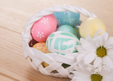 Decorated Easter eggs in a white basket