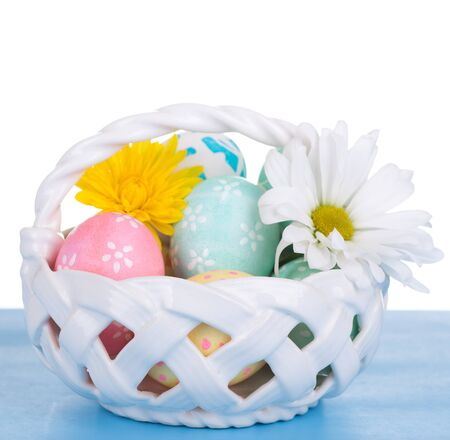 Decorated Easter eggs in a basket with white background Banco de Imagens