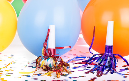 celebration: Birthday decorations of noisemakers and baloons Stock Photo