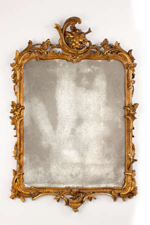 old antique guilded wall mirror carved. 18 - 19th century Stock Photo