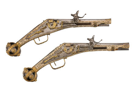 Pair early old antique wheelock flint pistols c1580-1590 sometimes called puffers,  isolated on white photo