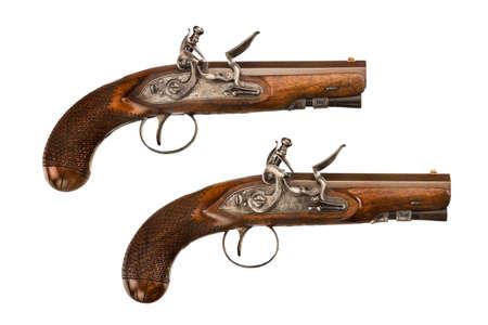 flint gun: Pair flintlock pistols old vintage antique short barreled isolated on white