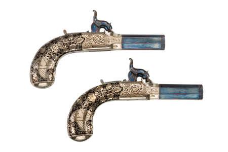 flint gun: Pair percussion pistols old vintage antique short barrelled, silver inlaid decoration isolated on white Foto de archivo