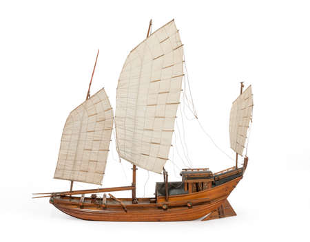 Junk boat model Chinese or Indian old vintage isolated on white background with clipping path