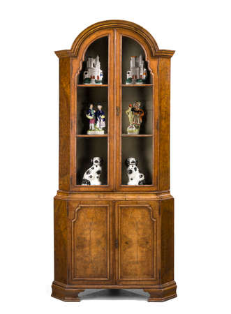 old antique corner cupboard in walnut and in the style of Queen Anne English isolated on white with clip path