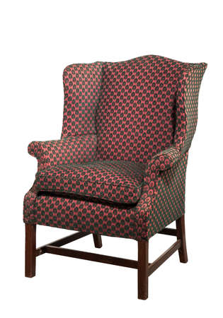 upholstered: Wing arm chair shapely in design red upholstered English antique isolated on white with clipping path