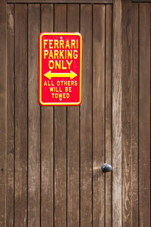 ferrari: Parking sign on a wall do not park unless a ferrari