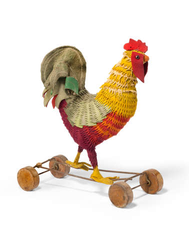 pull along: Colorful vintage childs toy rooster on wheels to pull along rare and unusual isolated on white