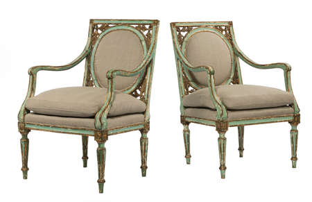 arm chairs: Antique green painted old arm chairs European with leaf pattern decorative isolated on white