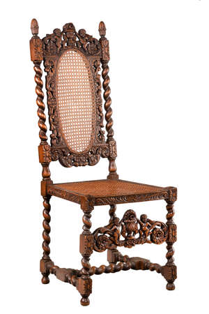 antique furniture: Elaborately carved walnut chair old vintage antique isolated on white Stock Photo