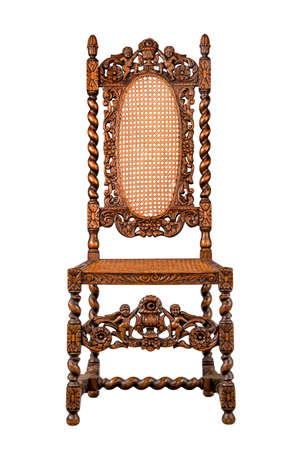 antique chair: Elaborately carved walnut chair old vintage antique isolated on white Stock Photo