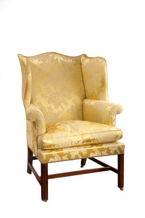 antique chair: old antique upholstered in yellow material wing arm chair 18 - 19th century