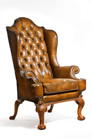 old furniture: old antique brown leather wing arm chair 18 - 19th century