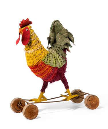 pull toy: Colorful vintage childs toy rooster on wheels to pull along rare and unusual isloated on white Foto de archivo