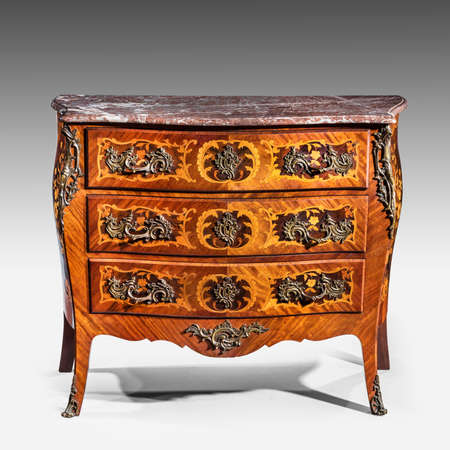marquetry: old vintage antique chest of drawers known as commode  wood inlaid ormalu furniture and marble top isolated on white with clipping path