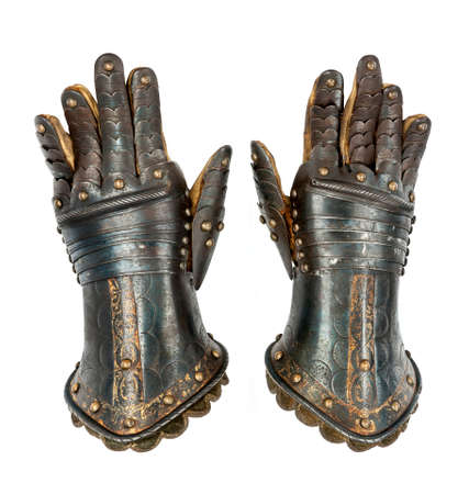 knight in armor: Pair of Knights armour gauntlets medievil ancient and original isolated with clipping path