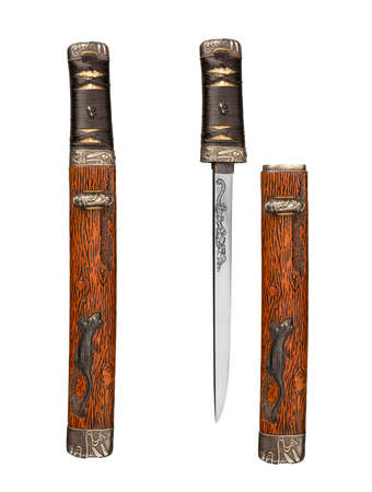 Old antique samurai dagger and scabbard shown in and out of scabbard isolated on white