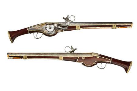 Pair early old antique wheelock flint long barrel pistols  isolated on white 免版税图像