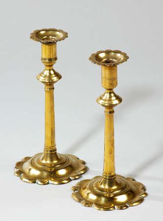 Old antique single brass ornate candlesticks