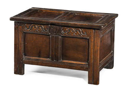 Old small coffer chest trunk early made from oak with detail carving and metal lock isolated with clipping path 免版税图像