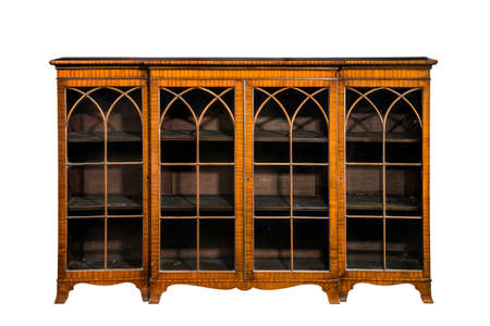 Antique inlaid empty wooden bookcase with glazed doors with clipping path
