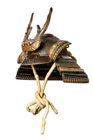 Original ancient Japenese warrior soldiers horned helmet in excellent condition isolated on white 免版税图像