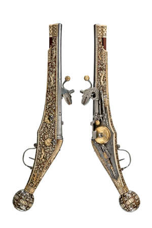 Pair early old antique wheelock flint pistols c1580-1590 sometimes called puffers,  isolated on white