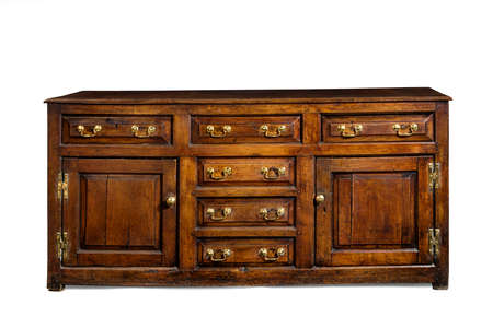 english oak: Old English antique oak dresser sideboard base with brass handles isolated with clip path 16th-17th Century