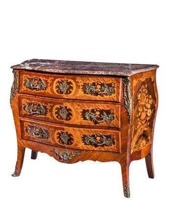 old vintage antique chest of drawers known as commode  wood inlaid ormalu furniture and marble top isolated on white with clipping path