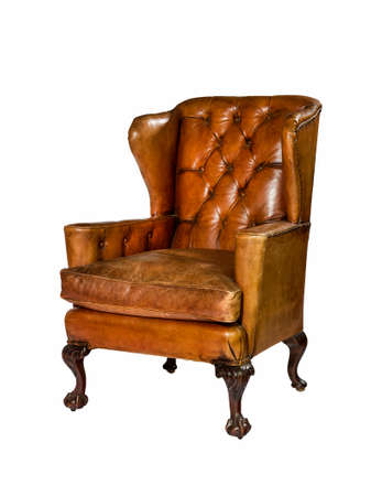 Old antique brown leather wing arm chair