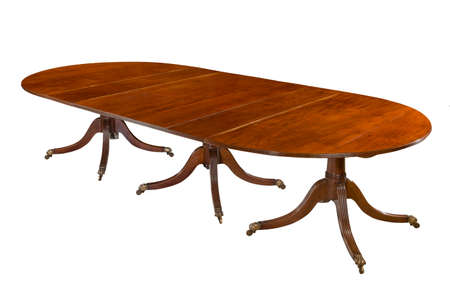 Dining table fully extended old antique made of mahogany elegant isolated on white with clipping path