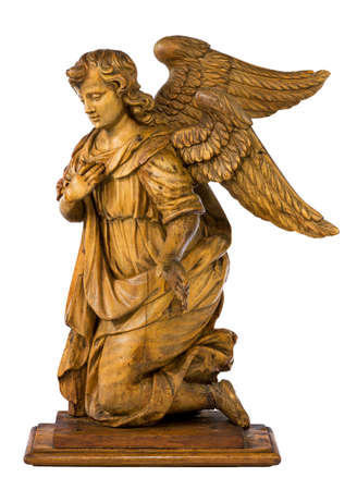 Lovely wooden carved kneeling Angel vintage isolated on white with clipping path