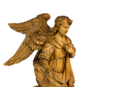 Lovely wooden carved kneeling Angel vintage wooden vintage  isolated on white with clipping 免版税图像