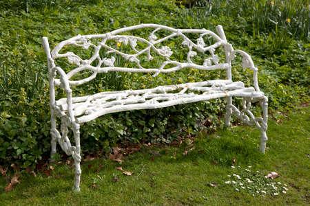Decorative ornate leaf patern cast antique garden or patio bench 免版税图像