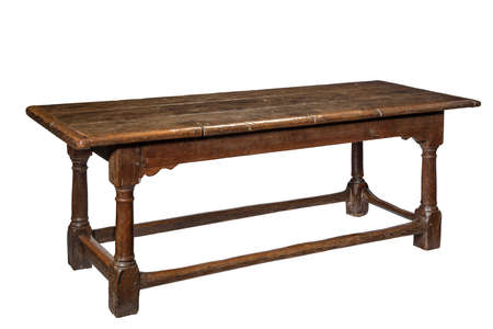 Original old antique seventeenth century oak refectory dining table isolated on white with clipping path 免版税图像