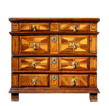old vintage antique trunk or dresser chest of drawers wood with geometric design isolated on white with clipping path.