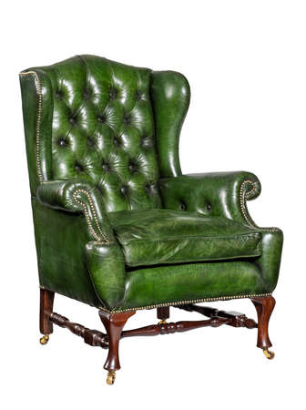 old comfortable antique green leather wing arm chair 18 - 19th century 免版税图像