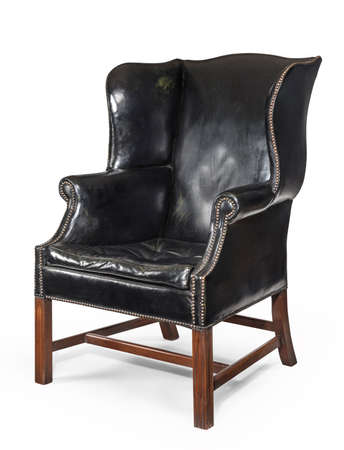 Old antique black leather wing arm chair 免版税图像
