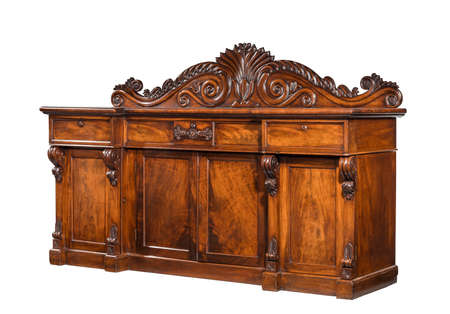 Old English mahogany antique dining dresser sideboard serving base with fine carving isolated with clip path