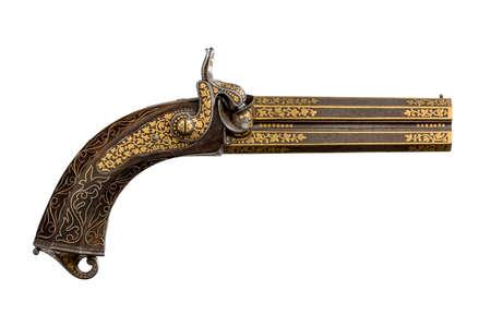 Old vintage double barrel ornate decorative gilded pistol